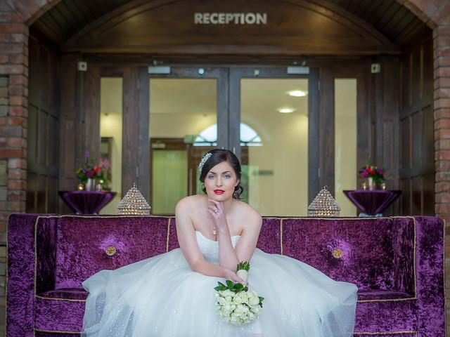 A Bride enjoying the sights in our stunning Stone Lobby