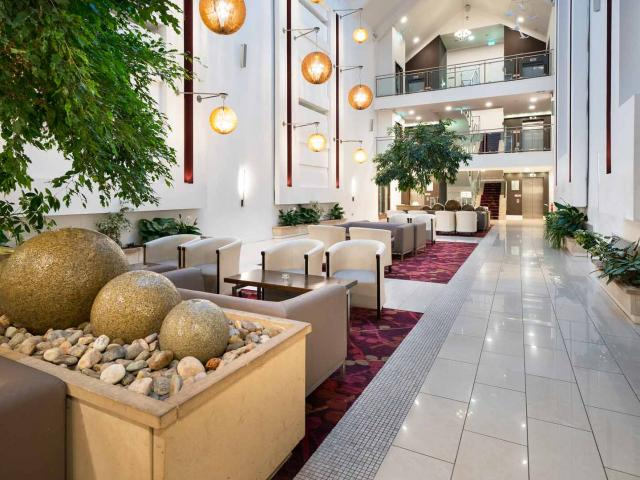 Our stunning Atrium Lobby with natural light, water feature and natural plants